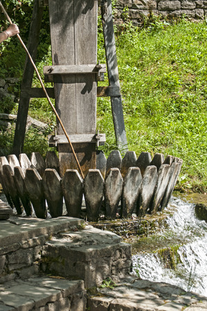 carpet wash: Old vintage wooden facility for washing of carpets and rugs powered by river water Stock Photo