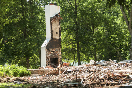 house demolition: Chimney of fireplace remain after demolition of house