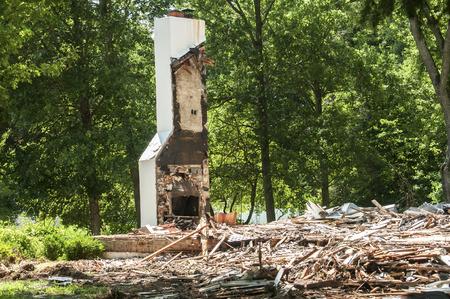 home destruction: Chimney of fireplace remain after demolition of house