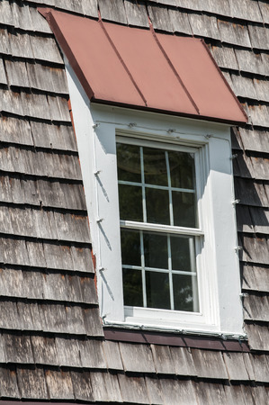 attic window: Attic window of pointed wooden roof of old house