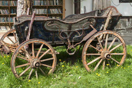Beautiful old rustic retro wooden cart in house garden