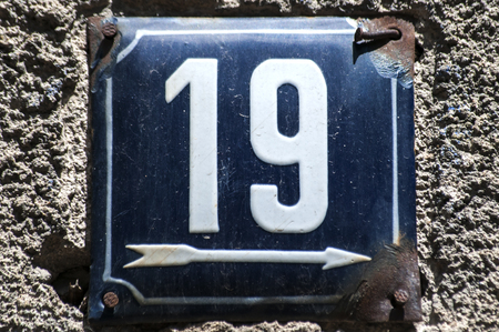 Weathered grunge square metal enameled plate of number of street address with number 19 closeup & House Number Plate Stock Photos. Royalty Free House Number Plate Images