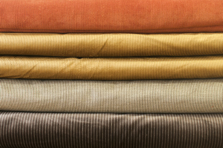 Cotton corduroy fabric in different colors closeup as background
