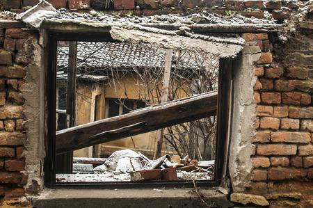 Grunge window frame of poor abandoned dirty demolished house closeup