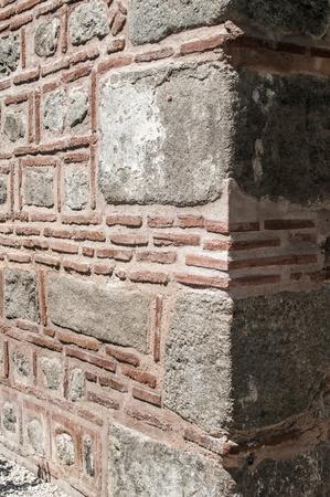 Corner of ancient Roman stone building wall closeup