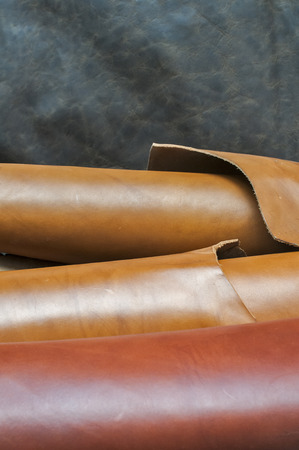 Closeup of various colors natural cow leather fabric rolls Stockfoto