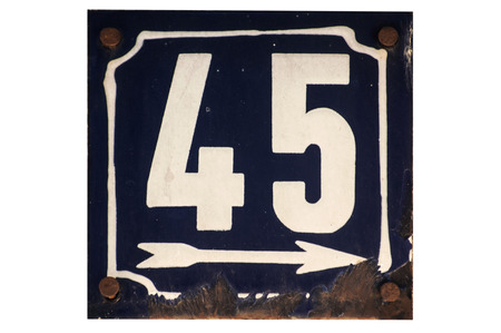 Weathered grunge square metal enameled plate of number of street address with number 45 closeup isolated on white background