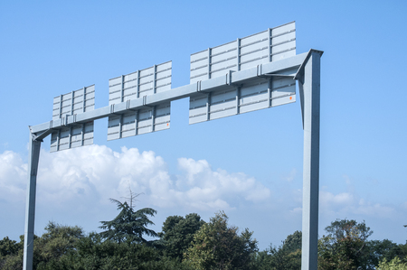 A backside of overhead roadsigns gantry construction in suuny day on blue sky background