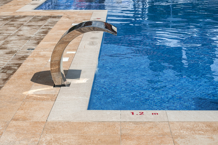 Detail of modern outdoor swimming pool in luxury hotel