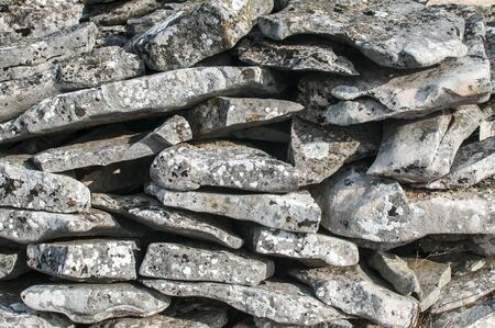 Pile of flat stone slabs closeup as stone background