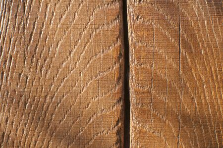 Oak wooden beam with polished surface and crack closeup