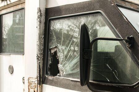 Broken side glass of armored bank truck closeup
