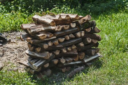 Stack of firewood closeup in rural house garden Stock Photo