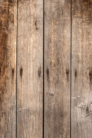 Old grunge weathered wooden boards closeup as wooden background