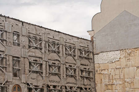 Strengthening of old facade wall of building with metal construction