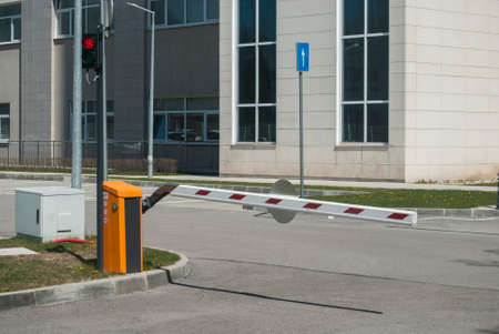 Car parking barrier system closeup at hospital parking lot
