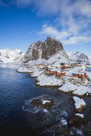 Hamnoy village in Lofoten Islands at mornig in winter, Norway, A small settlement by the sea in a quiet bay with high mountains in the background Stok Fotoğraf - 123544257