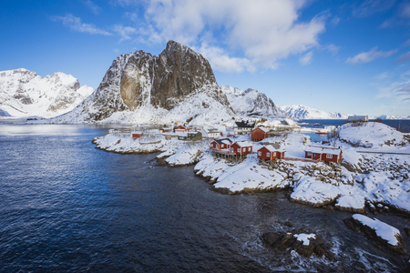 Hamnoy village in Lofoten Islands at mornig in winter, Norway, A small settlement by the sea in a quiet bay with high mountains in the background Stok Fotoğraf - 123544259