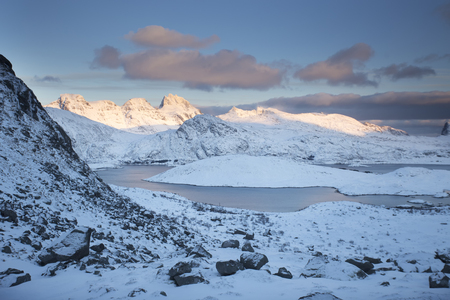 Beautiful landscape of high mountains and sea bay in the winter, hiking, amazing view in Norway on the Lofoten Islands