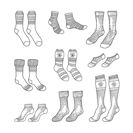 Black engraved socks drawing. Winter warm Christmas stockings set in ink hand drawn style vector illustration