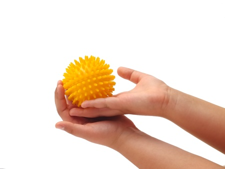 Massage ball in the hand of a little girl