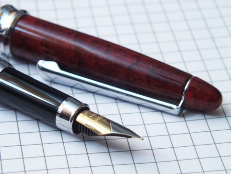 Old style pen with note book Stock Photo - 13514447