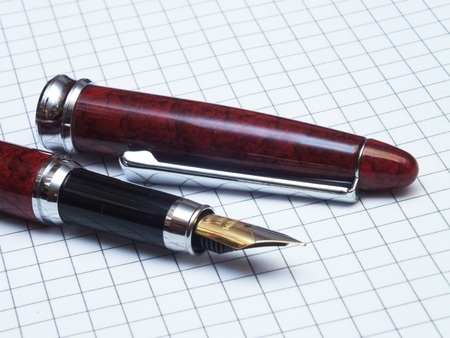 Old style pen with note book Stock Photo - 13514445