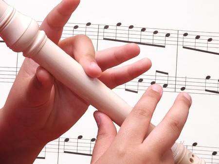 panpipe: Child playing on white recorder