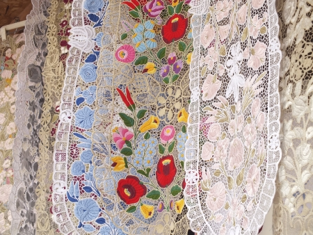 Handmade table cloth with floral embroidery in a market