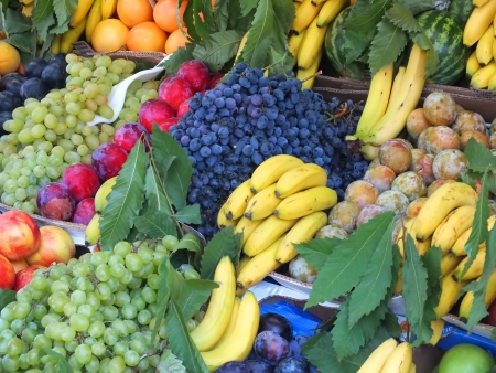 Fruit market with delicious fruits photo