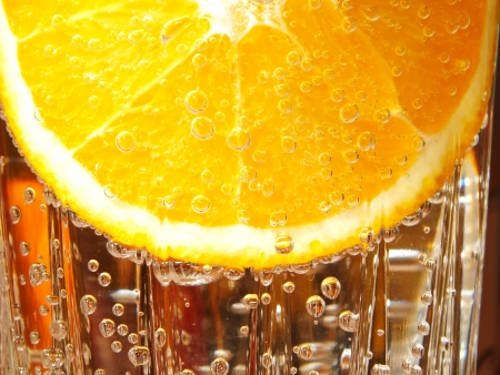 Orange slice in water with bubbles Stock Photo - 17068439