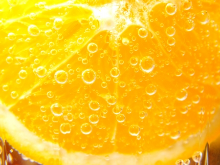 Orange slice in water with bubbles Stock Photo - 17068423