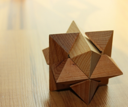 completing: Wooden 3D puzzle on the floor