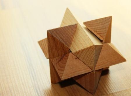 Wooden 3D puzzle on the floor