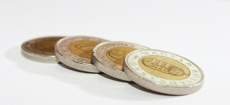 Some piece of hungarian coins are isolated on white photo