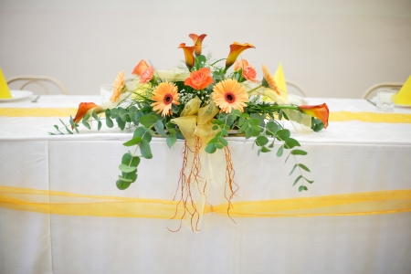 Flower composition on the white table with orange gerbers Stock Photo