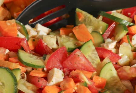 Mixed salad with carrot, tomato, cucumber and olive oil
