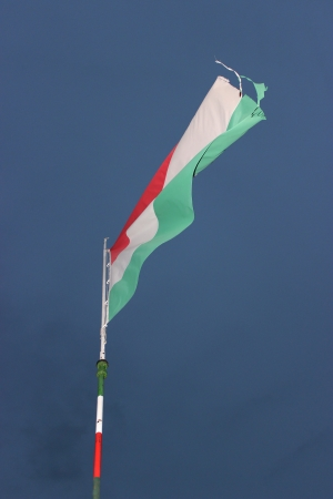 Waving Hungarian Flag Against Blue Sky  photo