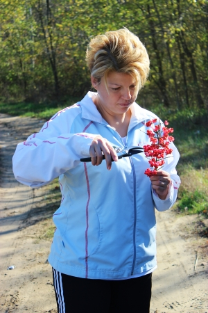 Woman wih scissors in the nature - Outdoor photography photo