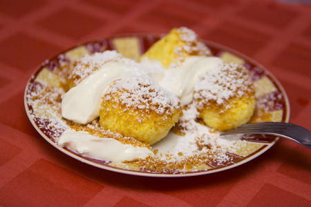 Cottage cheese dumplings with sour cream photo
