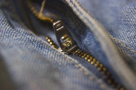 jeans zipper closeup with shallow depth of field 写真素材
