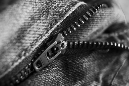 jeans zipper closeup with shallow depth of field Stock Photo