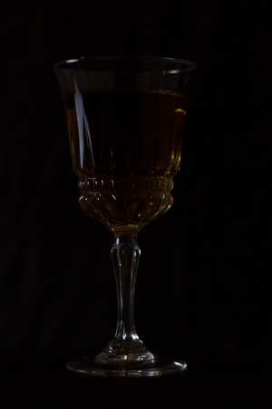Glass is filled with alcohol