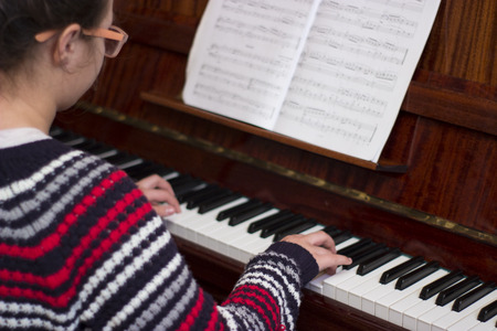 warble: Cute girl is learning play piano
