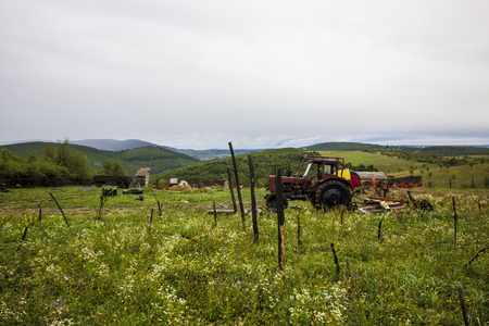 farm field: Old red tractor - object photography Stock Photo