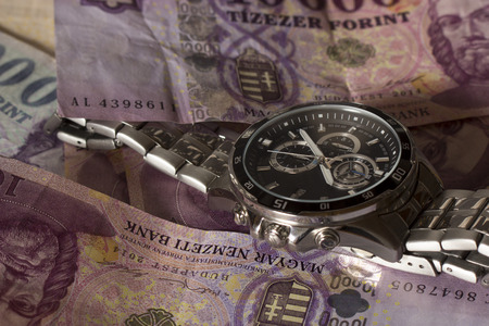 Watch and money concept for business investment, time is money