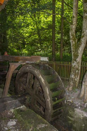 water mill: Historic water mill wheel in an outdoor museum, Hungary Editorial