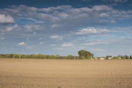 Plowed field withc? ? oudy sky - outdoor photography