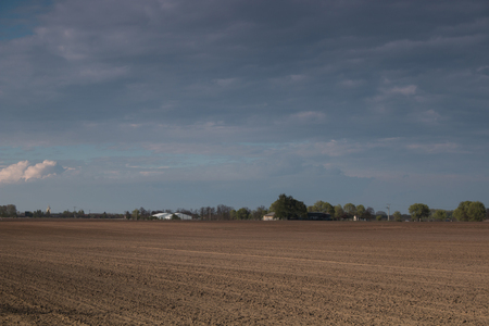 Plowed field withcéoudy sky - outdoor photography