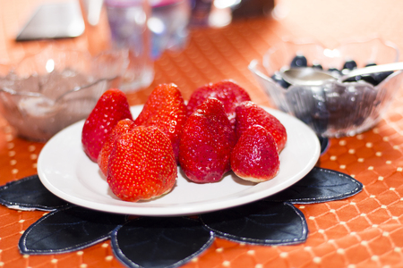 Fine and delicious strawberries on  a white plate Stock Photo